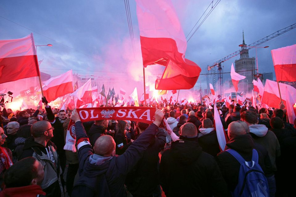 1072131-protesters-carry-polish-flags-and-national-radical-camp-flags-during-a-rally-organised-by-far-right-